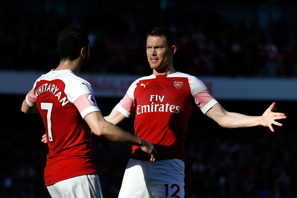 Arsenal's Armenian midfielder Henrikh Mkhitaryan (L) celebrates with Arsenal's Swiss defender Stephan Lichtsteiner after scoring their second goal during the English Premier League football match between Arsenal and Southampton at the Emirates Stadium in London on February 24, 2019. (Photo by Ian KINGTON / AFP)