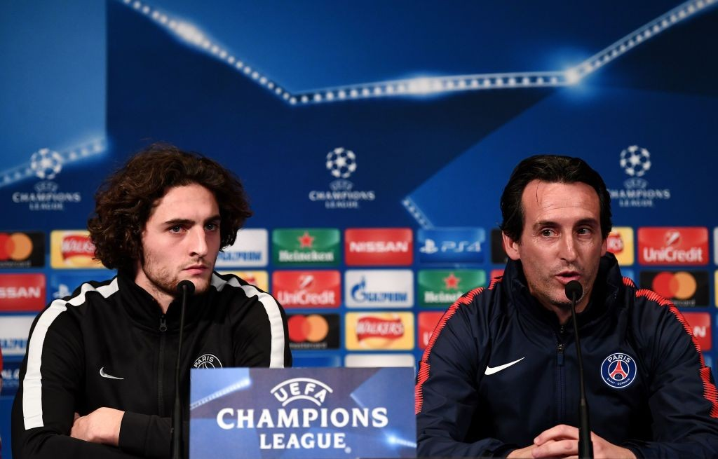 Paris Saint-Germain's Spanish headcoach Unai Emery (R) and Paris Saint-Germain's French midfielder Adrien Rabiot give a press conference at the Parc des Princes stadium in Paris on October 30, 2017 on the eve of the UEFA Champions League football match against Anderlecht. (Photo by FRANCK FIFE/AFP/Getty Images)