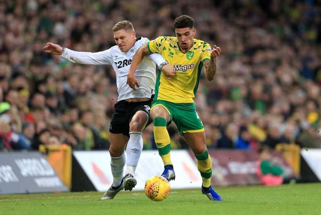 NORWICH, ENGLAND - DECEMBER 29: Ben Godfrey of Norwich City and Martyn Harrison of Derby County compete for the ball during the Sky Bet Championship match between Norwich City and Derby County at Carrow Road on December 29, 2018 in Norwich, England. (Photo by Stephen Pond/Getty Images)
