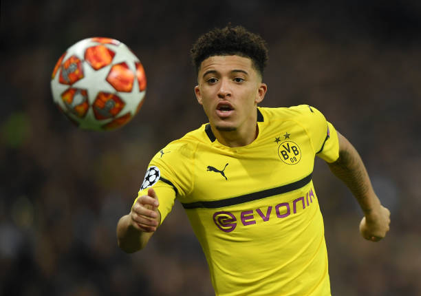 Jadon Sancho of Borussia Dortmund runs with the ball during the UEFA Champions League Round of 16 First Leg match between Tottenham Hotspur and Borussia Dortmund at Wembley Stadium on February 13, 2019 in London, England.