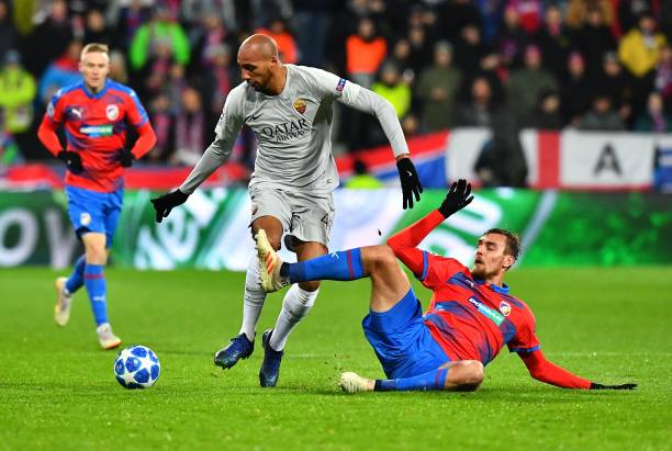 Roma's French midfielder Steven N'Zonzi (L) and Viktoria Plzen's Czech forward Tomas Chory vie for the ball during the UEFA Champions League group G football match between FC Victoria Plzen and AS Roma in Plzen, on December 12, 2018. (Photo by JOE KLAMAR / AFP)