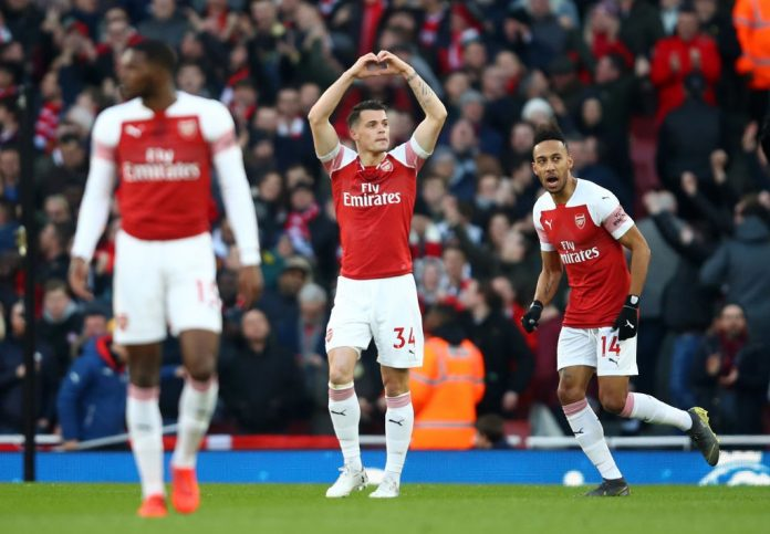 LONDON, ENGLAND - MARCH 10: Granit Xhaka of Arsenal celebrates after scoring his team's first goal during the Premier League match between Arsenal FC and Manchester United at Emirates Stadium on March 10, 2019, in London, United Kingdom. (Photo by Julian Finney/Getty Images)