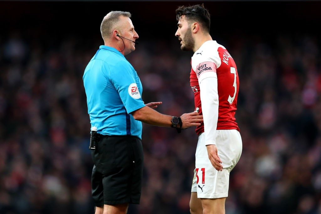 LONDON, ENGLAND - MARCH 10: Referee Jonathon Moss talks to Sead Kolasinac of Arsenal during the Premier League match between Arsenal FC and Manchester United at Emirates Stadium on March 10, 2019 in London, United Kingdom. (Photo by Catherine Ivill/Getty Images)