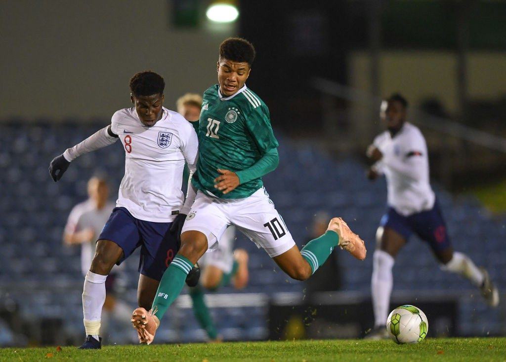 DUBLIN, IRELAND - NOVEMBER 11: Malik Tillman of Germany in action against Yunus Musah of England during the U17 International Friendly match between England and Germany at the UCD Bowl Stadium on November 10, 2018 in Dublin, Ireland. (Photo by Harry Murphy/Bongarts/Getty Images)