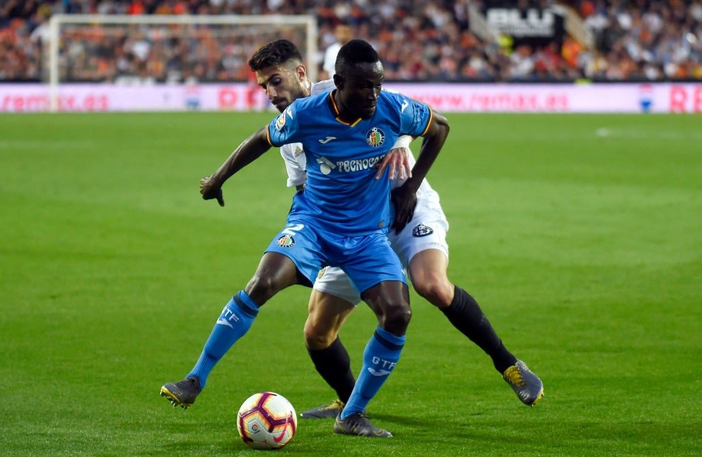 Getafe's Togolese defender Djene Ortega (L) vies with Valencia's Italian defender Cristiano Piccini during the Spanish league football match between Valencia CF and Getafe CF at the Mestalla stadium in Valencia on March 17, 2019. (Photo by JOSE JORDAN / AFP / Getty Images)
