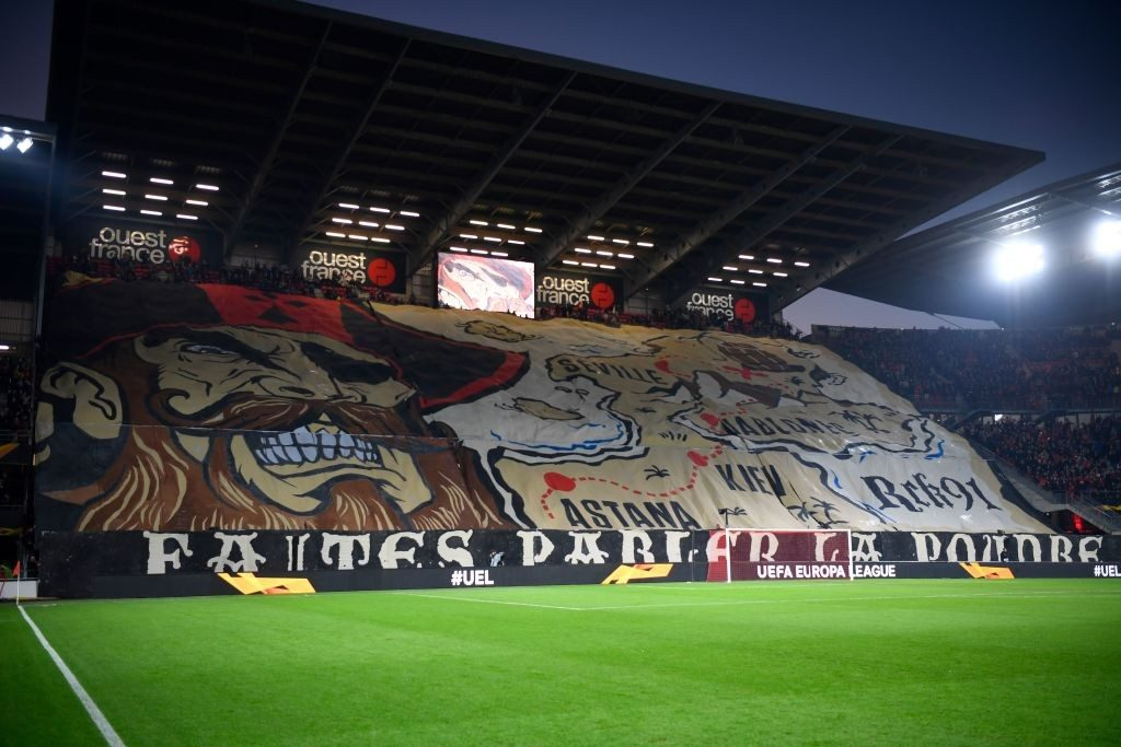 Rennes' supporters unveil a giant tifo before the UEFA Europa League round of 32 first-leg football match between Rennes and Real Betis at the Roazhon Park stadium in Rennes, western France, on February 14, 2019. (Photo by DAMIEN MEYER / AFP / Getty Images)