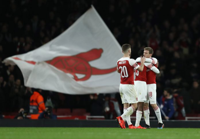 LONDON, ENGLAND - MARCH 14: Nacho Monreal of Arsenal celebrates with teammates Ainsley Maitland-Niles and Shkodran Mustafi after the UEFA Europa League Round of 16 Second Leg match between Arsenal and Stade Rennais at Emirates Stadium on March 14, 2019, in London, England. (Photo by Bryn Lennon/Getty Images)
