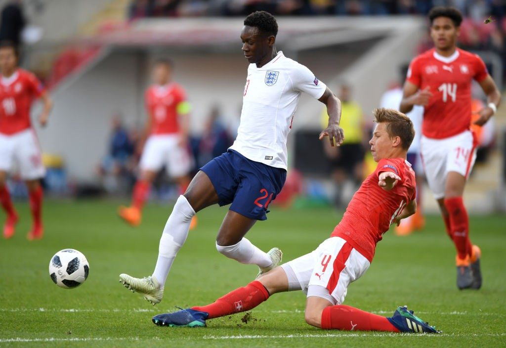 ROTHERHAM, ENGLAND - MAY 10: Folarin Balogun of England is tackled by Ilan Sauter of Switzerland during the UEFA European Under-17 Championship match between Switzerland and England at The New York Stadium on May 10, 2018 in Rotherham, England. (Photo by Gareth Copley/Getty Images)