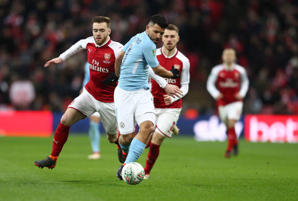LONDON, ENGLAND - FEBRUARY 25: Sergio Aguero of Manchester City battles with Calum Chambers of Arsenal during the Carabao Cup Final between Arsenal and Manchester City at Wembley Stadium on February 25, 2018 in London, England. (Photo by Catherine Ivill/Getty Images)