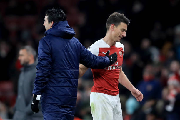 LONDON, ENGLAND - DECEMBER 13: Laurent Koscielny of Arsenal with Unai Emery manager of Arsenal during the UEFA Europa League Group E match between Arsenal and Qarabag FK at Emirates Stadium on December 13, 2018 in London, United Kingdom. (Photo by Marc Atkins/Getty Images)