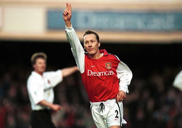 30 Dec 2000: Lee Dixon of Arsenal celebrates scoring Arsenals second goal during the match between Arsenal and Sunderland in the FA Carling Premiership at Highbury, London. Credit: Shaun Botterill/ALLSPORT