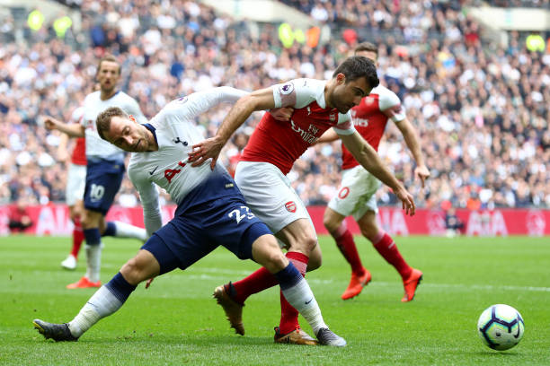 LONDON, ENGLAND - MARCH 02: Christian Eriksen of Tottenham Hotspur battles for possession with Sokratis Papastathopoulos of Arsenal during the Premier League match between Tottenham Hotspur and Arsenal FC at Wembley Stadium on March 02, 2019 in London, United Kingdom. (Photo by Clive Rose/Getty Images)