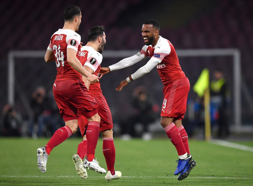 NAPLES, ITALY - APRIL 18: Alexandre Lacazette of Arsenal celebrates scoring his sides first goal with Granit Xhaka and Sead Kolasinac during the UEFA Europa League Quarter Final Second Leg match between S.S.C. Napoli and Arsenal at Stadio San Paolo on April 18, 2019 in Naples, Italy. (Photo by Stuart Franklin/Getty Images)