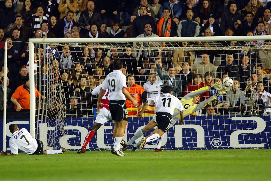 VALENCIA - MARCH 19: John Carew of Valencia scores the second and decisive goal during the UEFA Champions League Second Phase Group B match between Valencia and Arsenal held on March 19, 2003 at Mestalla Camp Del Valencia, in Valencia, Spain. Valencia won the match 2-1. (Photo by Ben Radford/Getty Images)
