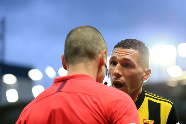 WATFORD, ENGLAND - FEBRUARY 09: Jose Holebas of Watford argues with the linesman during the Premier League match between Watford FC and Everton FC at Vicarage Road on February 9, 2019 in Watford, United Kingdom. (Photo by Marc Atkins/Getty Images)