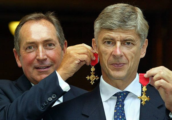 Gerard Houllier (L) of Liverpool holds his OBE medal as an earring on long-term friend and fellow manager Arsene Wenger of Arsenal, after being awarded their OBE medals at The Foreign Office in London 09 July 2003. The honor awarded by Foreign Secretary Jack Straw, is that of an officer in the Most Excellent Order of the British Empire. The British honors are awarded on merit for exceptional achievement of service to British interests. AFP PHOTO Adrian DENNIS / WPA POOL