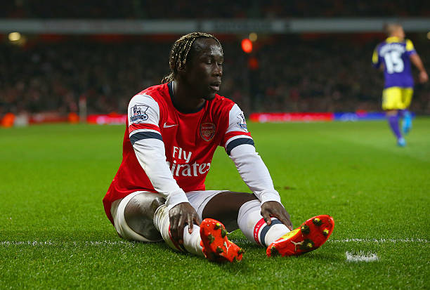 LONDON, ENGLAND - MARCH 25: Bacary Sagna of Arsenal reacts during the Barclays Premier League match between Arsenal and Swansea City at Emirates Stadium on March 25, 2014 in London, England. (Photo by Julian Finney/Getty Images)