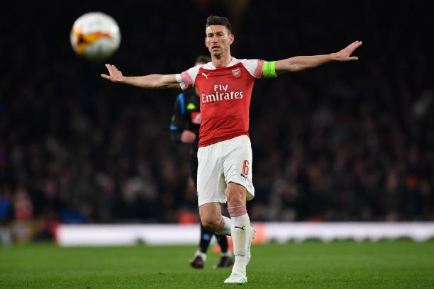 Arsenal's French defender Laurent Koscielny keeps an eye on the ball during the UEFA Europa League quarter final, first leg, football match between Arsenal and Napoli at the Emirates Stadium in London on April 11, 2019. (Photo by Ben STANSALL / AFP)
