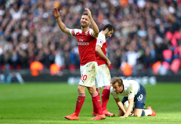 LONDON, ENGLAND - MARCH 02: Shkodran Mustafi of Arsenal reacts during the Premier League match between Tottenham Hotspur and Arsenal FC at Wembley Stadium on March 02, 2019 in London, United Kingdom. (Photo by Clive Rose/Getty Images)