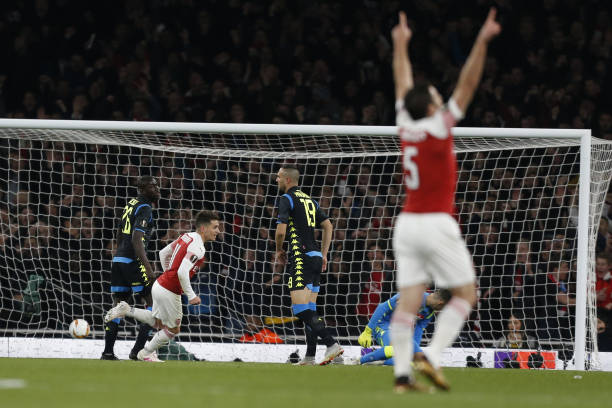 Arsenal's Uruguayan midfielder Lucas Torreira (2L) scores the team's second goal during the UEFA Europa League quarter final, first leg, football match between Arsenal and Napoli at the Emirates Stadium in London on April 11, 2019. (Photo by Ian KINGTON / IKIMAGES / AFP)