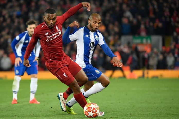 Liverpool's English striker Daniel Sturridge (L) vies for the ball with Porto's Algerian midfielder Yacine Brahimi (R) during the UEFA Champions League quarter-final, first leg football match between Liverpool and FC Porto at Anfield stadium in Liverpool, north-west England on April 9, 2019. (Photo by LLUIS GENE / AFP / Getty Images)