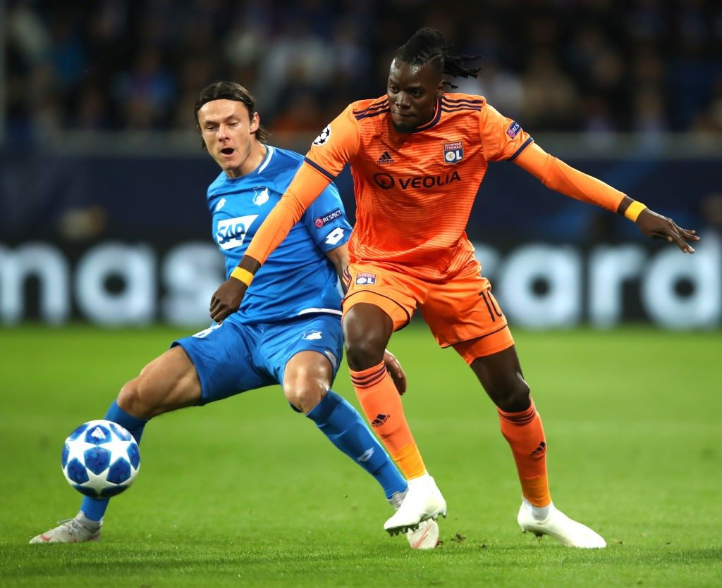 SINSHEIM, GERMANY - OCTOBER 23: Bertrand Traore of Olympique Lyonnais is challenged by Nico Schulz of 1899 Hoffenheim during the Group F match of the UEFA Champions League between TSG 1899 Hoffenheim and Olympique Lyonnais at Wirsol Rhein-Neckar-Arena on October 23, 2018 in Sinsheim, Germany. (Photo by Alex Grimm/Bongarts/Getty Images)