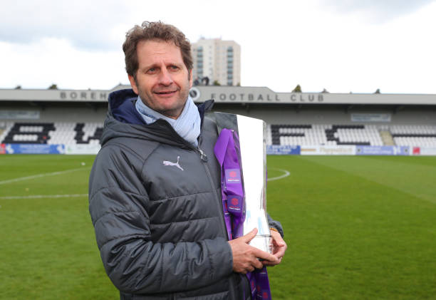 BOREHAMWOOD, ENGLAND - MAY 11: Joe Montemurro manager / head coach of Arsenal celebrates with the trophy after the WSL match between Arsenal Women and Manchester City at Meadow Park on May 11, 2019 in Borehamwood, England. (Photo by Catherine Ivill/Getty Images)