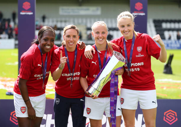 BOREHAMWOOD, ENGLAND - MAY 11: Danielle Carter, Jordan Nobbs, Beth Mead and Leah Williamson of Arsenal celebrate with the trophy after the WSL match between Arsenal Women and Manchester City at Meadow Park on May 11, 2019 in Borehamwood, England. (Photo by Catherine Ivill/Getty Images)