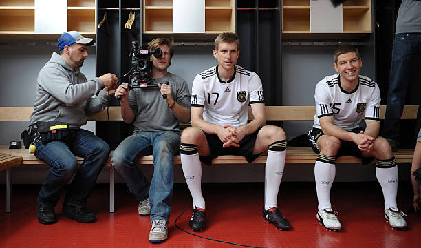 STUTTGART, GERMANY - JANUARY 25: Per Mertesacker (2nd R) and Thomas Hitzlsperger of Germany pose during a record of a Mercedes Benz television advert for the FIFA Wolrd Cup 2010 at the Mercedes Benz Arena on January 25, 2010 in Stuttgart, Germany. (Photo by Markus Gilliar-Pool/Bongarts/Getty Images)