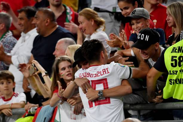 Hungary's midfielder Dominik Szoboszlai celebrates his team's victory over Wales with supporters after the UEFA Euro 2020 qualifier Group E football match Hungary against Wales on June 11, 2019 in Budapest. (Photo by ATTILA)