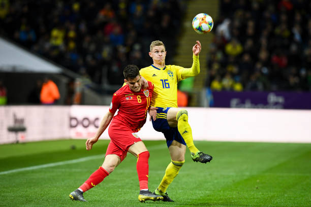 Sweden's defender Emil Krafth (R) and Romania's forward Ianis Hagi vie for the ball during the Euro 2020 football 1st round Groupe F qualification match between Sweden and Romania on March 23, 2019 in Solna. (Photo by Jonathan NACKSTRAND / AFP)