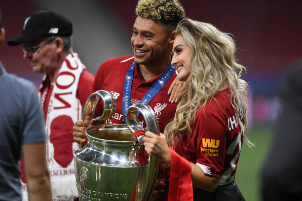 MADRID, SPAIN - JUNE 01: Alex Oxlade-Chamberlain of Liverpool celebrates with his girlfriend Perrie Edwards after his side won during the UEFA Champions League Final between Tottenham Hotspur and Liverpool at Estadio Wanda Metropolitano on June 01, 2019 in Madrid, Spain. (Photo by Michael Regan/Getty Images)