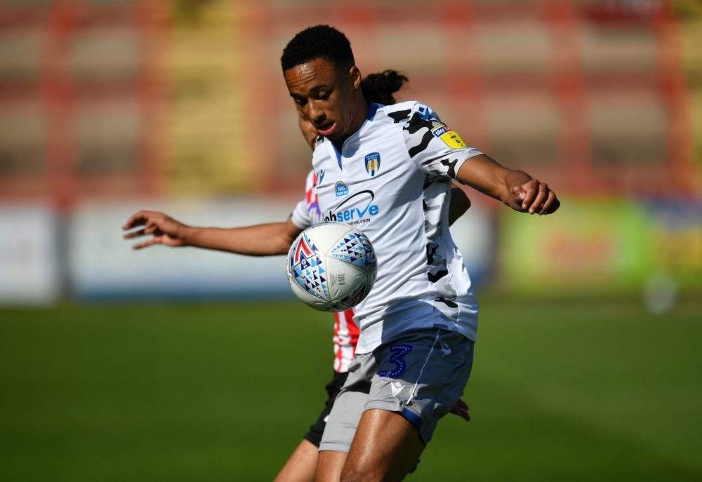 EXETER, ENGLAND - JUNE 22: Cohen Bramall of Colchester United holds off Randell Williams of Exeter City during the Sky Bet League Two Play Off Semi-final 2nd Leg match between Exeter City and Colchester United at St James Park on June 22, 2020 in Exeter, England. (Photo by Dan Mullan/Getty Images)