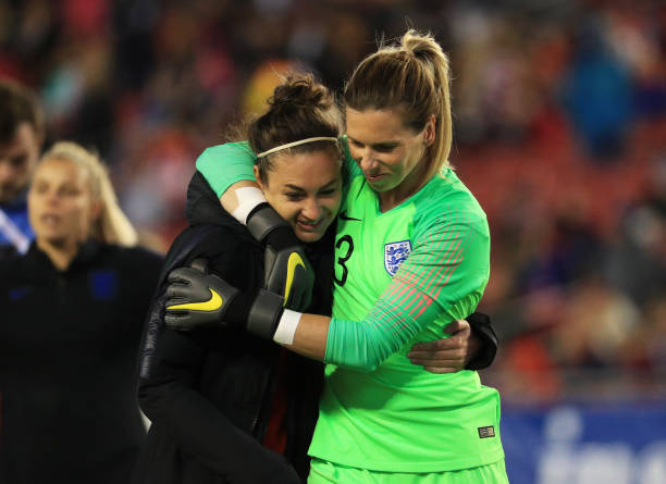 TAMPA, FLORIDA - MARCH 05:  Jodie Taylor and Carly Telford of England celebrate victory after the 2019 SheBelieves Cup  match between England and Japan at Raymond James Stadium on March 05, 2019 in Tampa, Florida. (Photo by Mike Ehrmann/Getty Images)