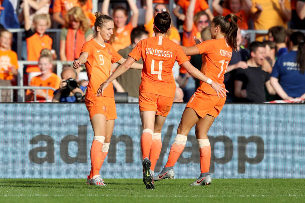EINDHOVEN, NETHERLANDS - JUNE 01: Vivianne Miedema of Netherlands (L) celebrates the second goal with Merel van Dongen (C) and Lieke Martens (R) during the international friendly match beweteen Netherlands Women and Australia Women at Phillips Stadium on June 01, 2019 in Eindhoven, Netherlands. (Photo by Christof Koepsel/Getty Images)