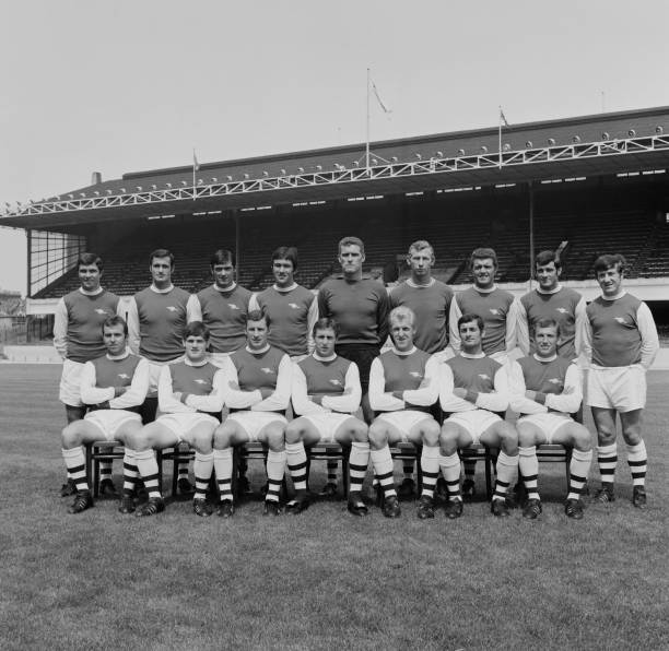 English soccer team Arsenal FC, group photo, UK, 8th August 1968; they are Jon Sammels, Peter Storey, George Armstrong, Ian Ure, Jim Furnell, David Court, John Radford, Terry Neill, Peter Simpson, Bob McNab, Bobby Gould, Bob Wilson, David Jenkins, George Graham, Pat Rice, Bertie Mee, Frank McLintock. (Photo by Evening Standard/Hulton Archive/Getty Images)