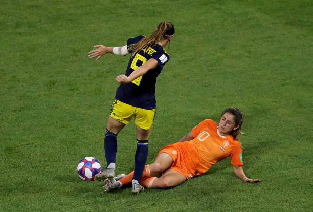 LYON, FRANCE - JULY 03: Kosovare Asllani of Sweden is challenged by Danielle Van De Donk of the Netherlands during the 2019 FIFA Women's World Cup France Semi Final match between Netherlands and Sweden at Stade de Lyon on July 03, 2019 in Lyon, France. (Photo by Elsa/Getty Images)