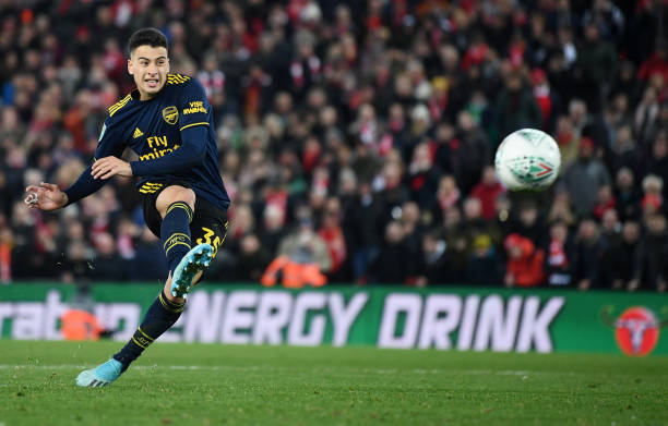 LIVERPOOL, ENGLAND - OCTOBER 30: Gabriel Martinelli of Arsenal scores his sides third penalty during the penalty shoot out during the Carabao Cup Round of 16 match between Liverpool and Arsenal at Anfield on October 30, 2019 in Liverpool, England. (Photo by Laurence Griffiths/Getty Images)