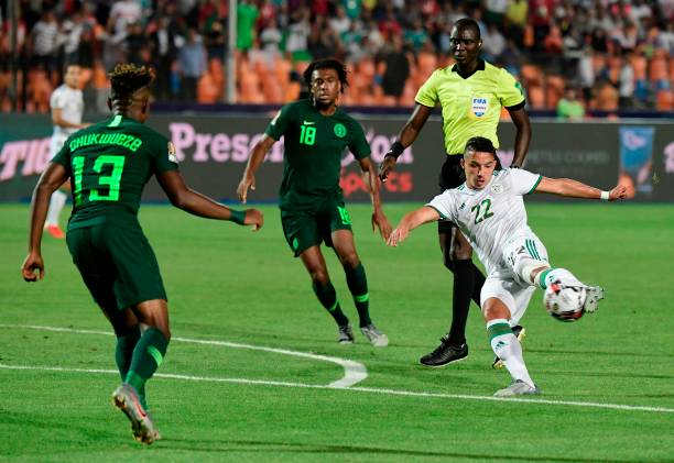 Algeria's midfielder Ismail Bennacer (R) attempts a shot during the 2019 Africa Cup of Nations (CAN) Semi-final football match between Algeria and Nigeria at the Cairo International stadium in Cairo on July 14, 2019. (Photo by JAVIER SORIANO / AFP)