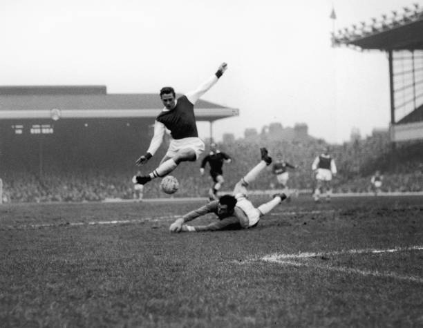 Arsenal inside right John Radford leaps over Leicester City goalkeeper Gordon Banks during a first division match at Highbury, London, 23rd January 1965. (Photo by Ted West/Central Press/Hulton Archive/Getty Images)