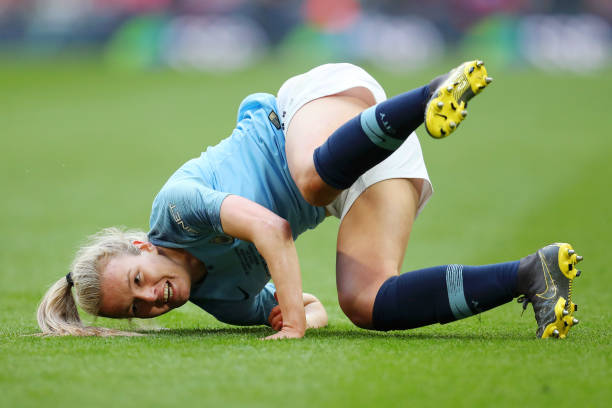 LONDON, ENGLAND - MAY 04: Lauren Hemp of Manchester City Women falls to the ground as she scores her team's third goal during the Women's FA Cup Final match between Manchester City Women and West Ham United Ladies at Wembley Stadium on May 04, 2019 in London, England. (Photo by Catherine Ivill/Getty Images)