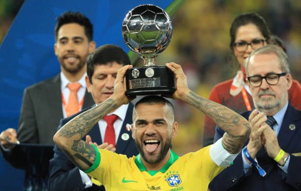 RIO DE JANEIRO, BRAZIL - JULY 07: Dani Alves of Brazil poses with the trophy of Best Player of the tournament after winning the Copa America Brazil 2019 Final match between Brazil and Peru at Maracana Stadium on July 07, 2019 in Rio de Janeiro, Brazil. (Photo by Buda Mendes/Getty Images)