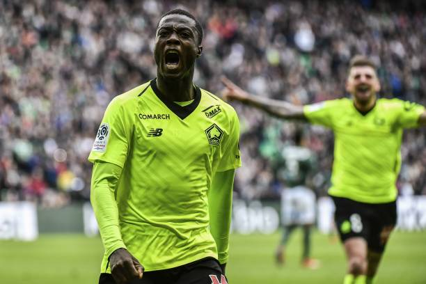 Lille's Ivorian forward Nicolas Pepe celebrates after scoring a goal during the L1 football match AS Saint-Etienne (ASSE) vs Lille (LOSC) on March 10, 2019, at the Geoffroy Guichard Stadium in Saint-Etienne, central France. (Photo by JEFF PACHOUD / AFP)