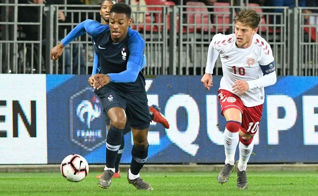 France's midfielder Jeff Reine-Adelaide (L) fights for the ball with Denmark's midfielder Mathias Jensen during the friendly U21 football match between France and Denmark on March 24, 2019 at the Francis Le Ble stadium in Brest, western France. (Photo by Fred TANNEAU / AFP / Getty Images)