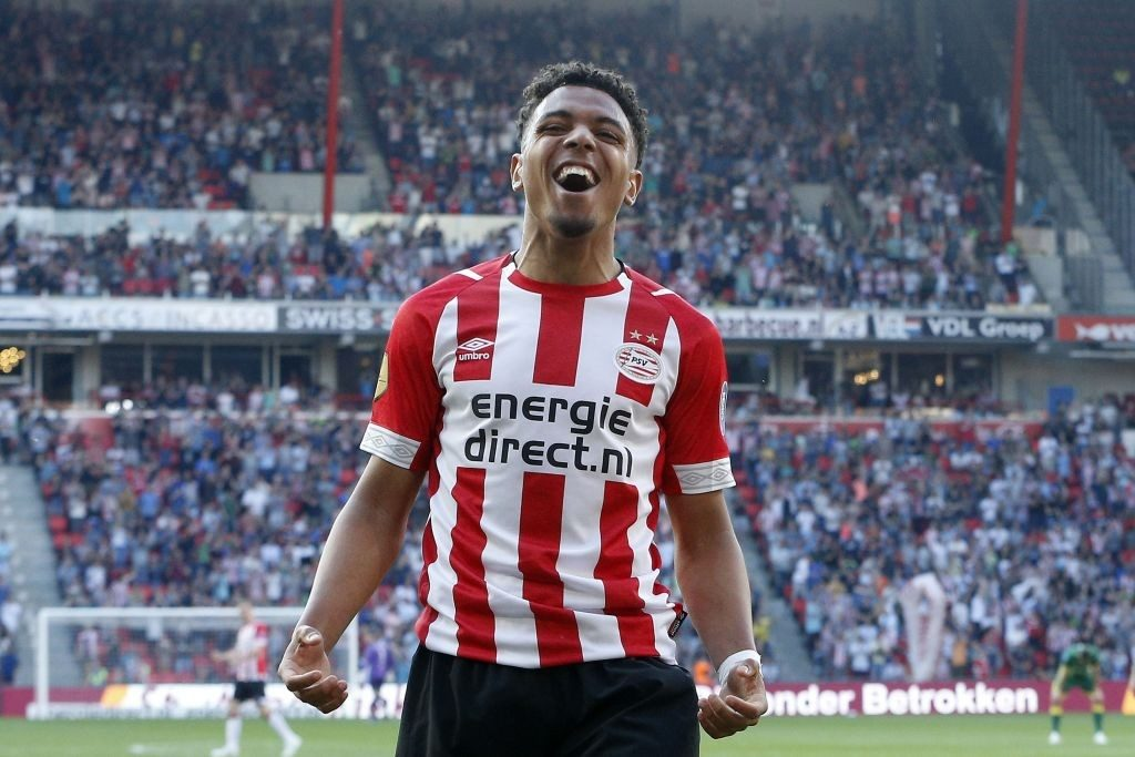PSV Eindhoven's Dutch forward Donyell Malen celebrates after scoring a goal during the Dutch Eredivisie match between PSV Eindhoven and ADO den Haag at the Phillips stadium on April 21, 2019, in Eindhoven. (Photo by Jeroen PUTMANS / ANP / AFP / Getty Images)