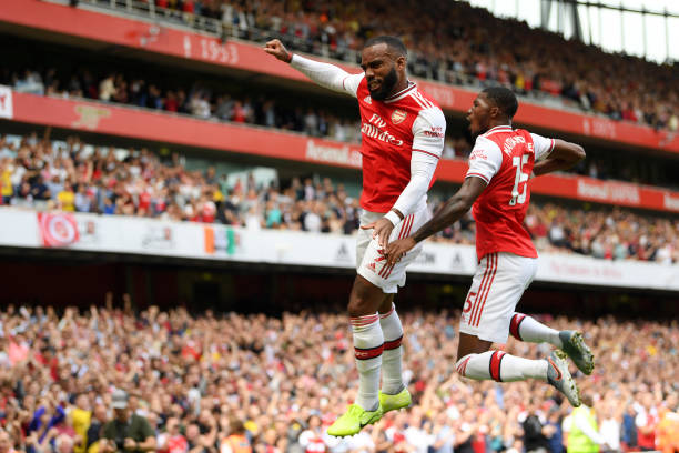 LONDON, ENGLAND - AUGUST 17: Alexandre Lacazette of Arsenal celebrates after scoring his team's first goal with Ainsley Maitland-Niles during the Premier League match between Arsenal FC and Burnley FC at Emirates Stadium on August 17, 2019 in London, United Kingdom. (Photo by Michael Regan/Getty Images)