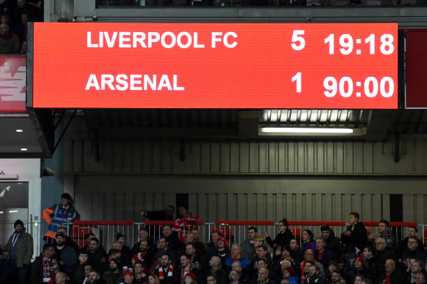 The scoreboard shows the final score for 5-1 to Liverpool at the 90 minute mark during the English Premier League football match between Liverpool and Arsenal at Anfield in Liverpool, north west England on December 29, 2018. - Liverpool won the match 5-1. (Photo by Paul ELLIS / AFP)