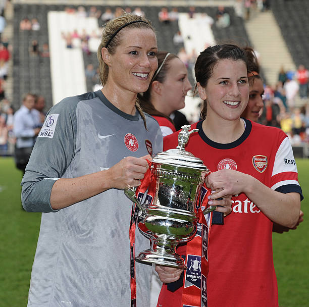 MILTON KEYNES, ENGLAND - JUNE 01: Emma Byrne and Niamh Fahey of Arsenal Ladies with the trophy after winning the FA Women's Cup Final match between Everton Ladies and Arsenal Ladies at Stadium mk on June 1, 2014 in Milton Keynes, England. (Photo by Tony Marshall/Getty Images)