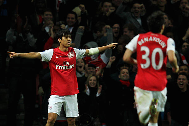 LONDON, ENGLAND - OCTOBER 25: Park Chu-Young of Arsenal is congratulated by team mates after scoring his teams second goal of the game during the Carling Cup Fourth Round match between Arsenal and Bolton Wanderers at Emirates Stadium on October 25, 2011 in London, England. (Photo by Dean Mouhtaropoulos/Getty Images)