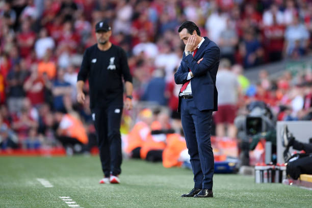 LIVERPOOL, ENGLAND - AUGUST 24: Unai Emery, Manager of Arsenal looks dejected in the final minutes of the Premier League match between Liverpool FC and Arsenal FC at Anfield on August 24, 2019 in Liverpool, United Kingdom. (Photo by Laurence Griffiths/Getty Images)